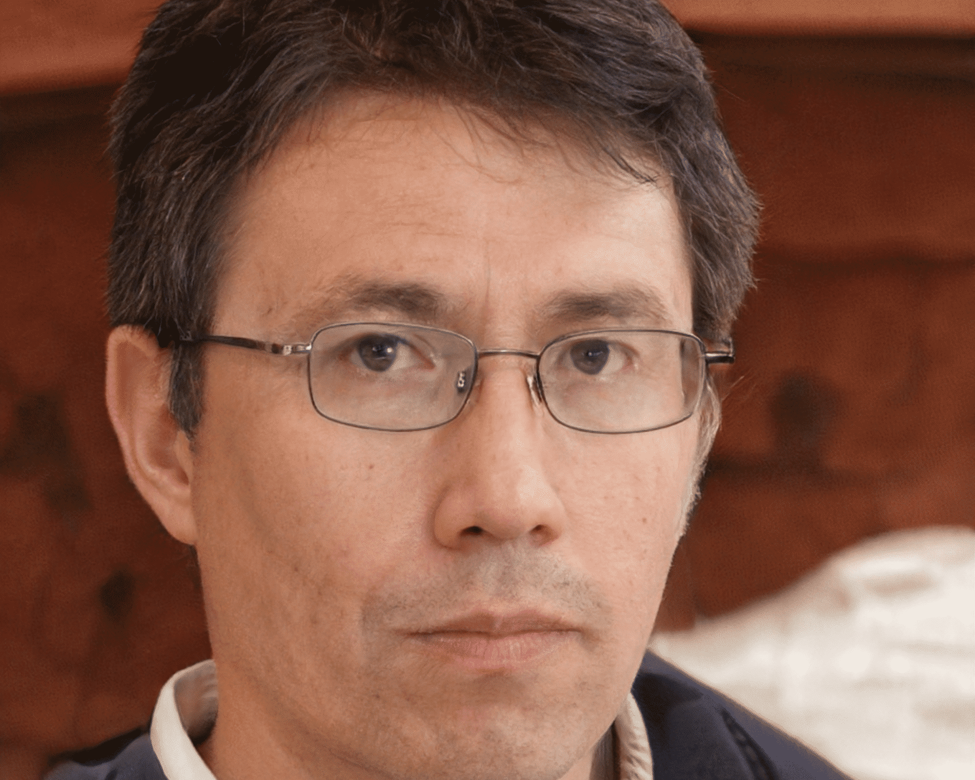 a man wearing glasses with brown hair