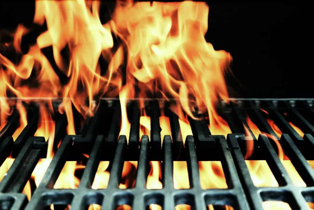 Fire flames on a grill grate