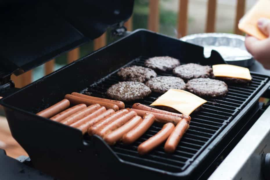Sausage, cheese and meat on a gas grill